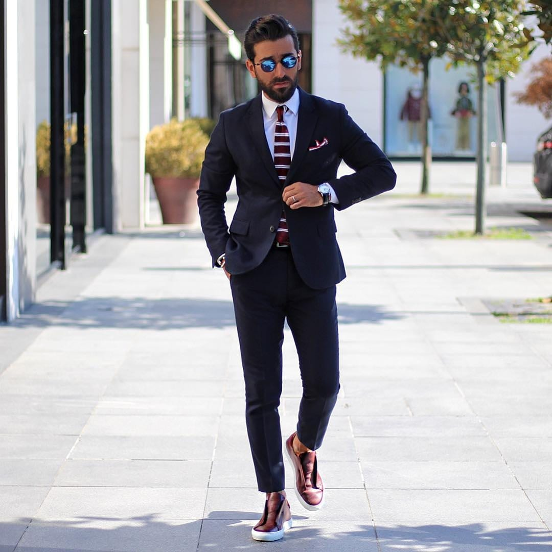 Navy Blue Suit With Knit Striped tie