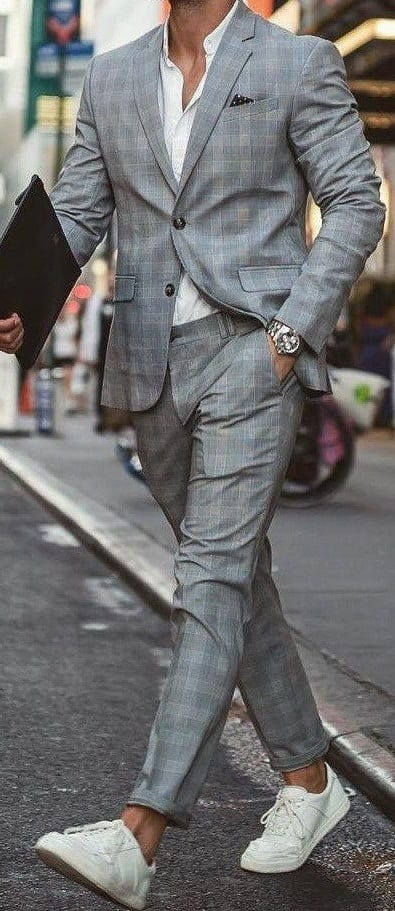 suit with white sneakers
